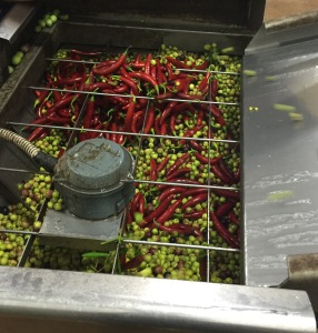 Fresh chilis to be crushed with olives